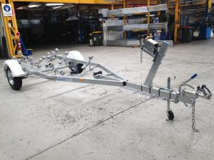 Single Axle braked multi roller boat trailer